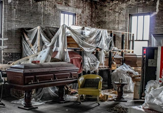 <p><span>An abandoned funeral home that is more than 150 years old was left to rot, its premises eerily strewn with open caskets, a hearse and embalming chemicals. </span>(Photo: Caters News) </p>