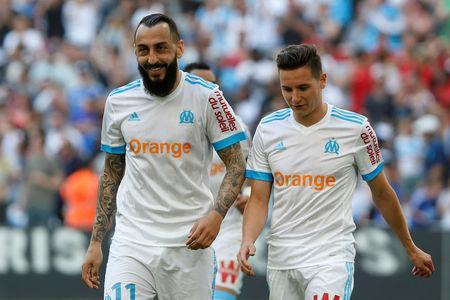 Soccer Football - Ligue 1 - Olympique de Marseille vs LOSC Lille - Orange Velodrome, Marseille, France - April 21, 2018 Marseille's Konstantinos Mitroglou celebrates scoring their fourth goal with Florian Thauvin. REUTERS/Philippe Laurenson