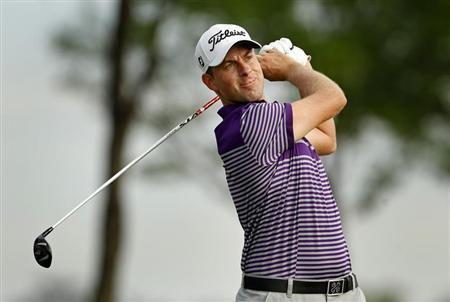 Webb Simpson of the U.S. watches his tee shot on the 13th hole during the weather delayed first round of the Barclays PGA golf tournament in Jersey City, New Jersey August 23, 2013. REUTERS/Adam Hunger