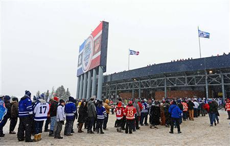 Spectators wait in a long line prior to entering Michigan Stadium for the 2014 Winter Classic hockey game between the Detroit Red Wings and the Toronto Maple Leafs at Michigan Stadium. Mandatory Credit: Andrew Weber-USA TODAY Sports