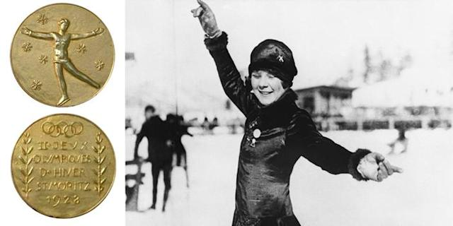 <p>The medals for the 1928 Olympic Winter Games featured a skater with her arms wide open, snowflakes, and the Olympic Rings.<br> (IOC photo; Norwegian figure skater Sonja Henie shows off her gold medal at the 1928 Olympics in St. Moritz, Switzerland/Getty Images) </p>
