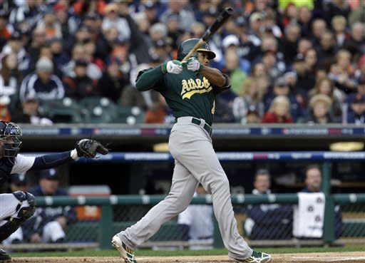 Oakland Athletics' Coco Crisp hits a home run during the first inning of Game 1 of the American League division baseball series against the Detroit Tigers, Saturday, Oct. 6, 2012, in Detroit. (AP Photo/Paul Sancya)
