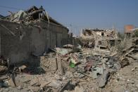 Ali Ibrahimov works on the ruins of his home, which was hit by a rocket, in the city of Ganja
