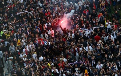 psg fans lighting a flare - Credit: GETTY IMAGES