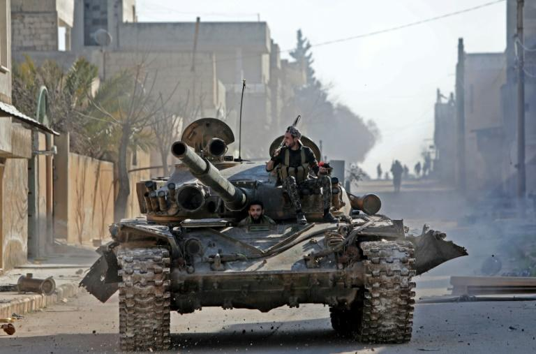 A rebel tank patrols the streets of Saraqeb, reduced to a ghost town abandoned by its residents after weeks of fighting (AFP Photo/Bakr ALKASEM)