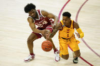 Iowa State guard Tyler Harris tries to steal the ball from Oklahoma guard Elijah Harkless, left, during the first half of an NCAA college basketball game, Saturday, Feb. 20, 2021, in Ames, Iowa. (AP Photo/Charlie Neibergall)