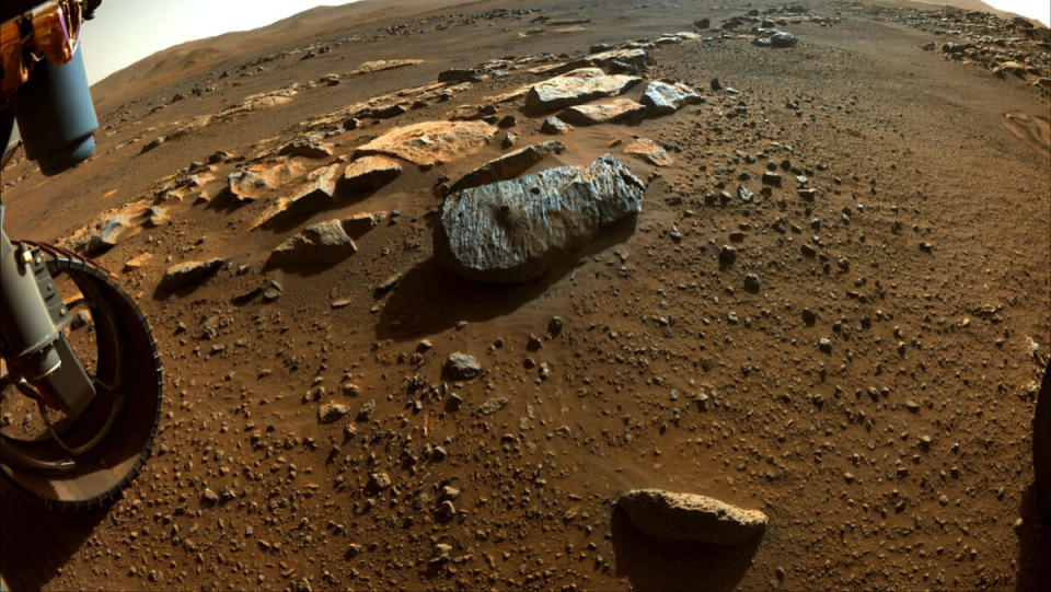 A rich, colorful look at the rust-colored Martian surface and the rocks of Mars.