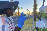 Elisheyah M., 61, who had been homeless for about a year when the pandemic started, gestures while speaking in Phoenix on May 25, 2020. She was couch-surfing prior to moving into a sanctioned outdoor encampment, located on a parking lot near downtown Phoenix. She hopes to move to a hotel room in the future. Homeless people are among the most vulnerable populations in the COVID-19 pandemic, yet they're largely invisible victims. (Elizabeth Veneable and the Howard Center For Investigative Journalism via AP)
