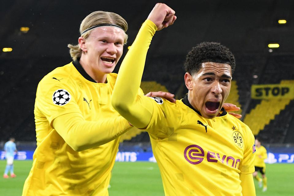 <p>Jude Bellingham celebrates with Borussia Dortmund team-mate Erling Haaland after scoring against Man City</p> (AFP via Getty Images)