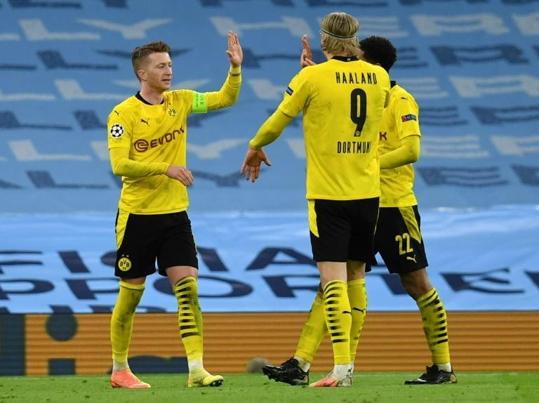Borussia Dortmund captain Marco Reus (L) celebrates his goal at Manchester City in Tuesday's 2-1 away defeat