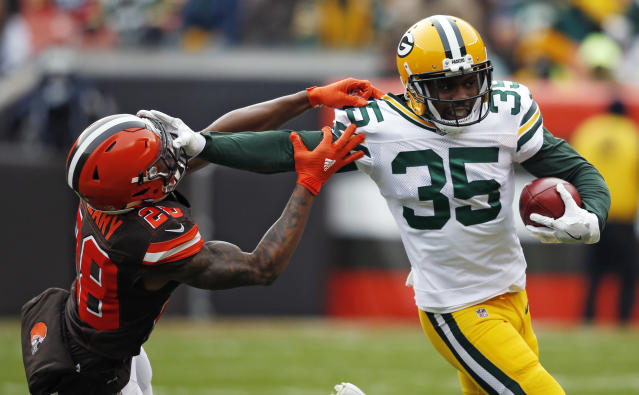 <p>Green Bay Packers free safety Jermaine Whitehead (35) holds off Cleveland Browns defensive back Darrius Hillary (28) for a first down in the first half of an NFL football game, Sunday, Dec. 10, 2017, in Cleveland. (AP Photo/Ron Schwane) </p>