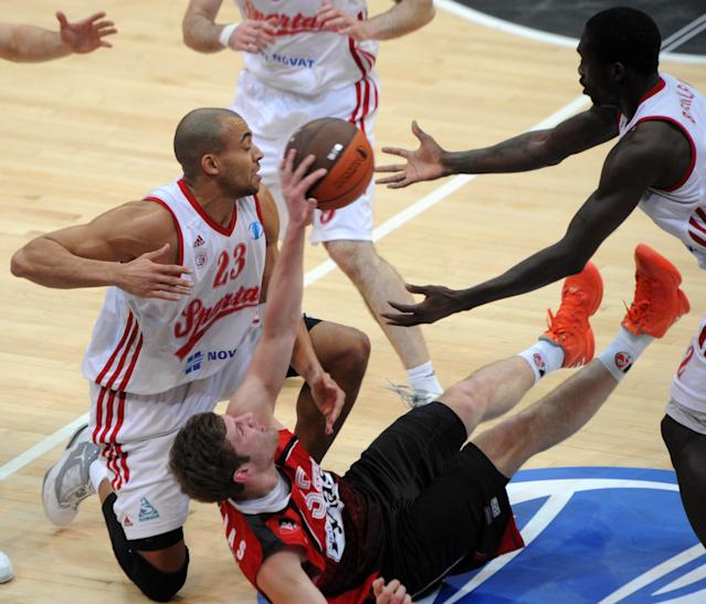 Lietuvos Rytas' Dovydas Redikas (C) vies with BC Spartak Saint-Petersburg's Victor Keyru (L) and Patrick Beverley during Eurocup's FinalFour third place basketball match between Lietuvos Rytas and BC Spartak Saint-Petersburg in Khimki, a suburb of Moscow, on April 15, 2012. AFP PHOTO/ KIRILL KUDRYAVTSEV (Photo credit should read KIRILL KUDRYAVTSEV/AFP/Getty Images)