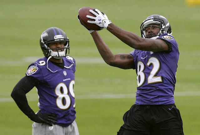 Baltimore Ravens wide receiver Torrey Smith, right, catches a pass in front of teammate Steve Smith during an NFL football organized team activity, Thursday, May 29, 2014, at the team's practice facility in Owings Mills, Md. (AP Photo/Patrick Semansky)