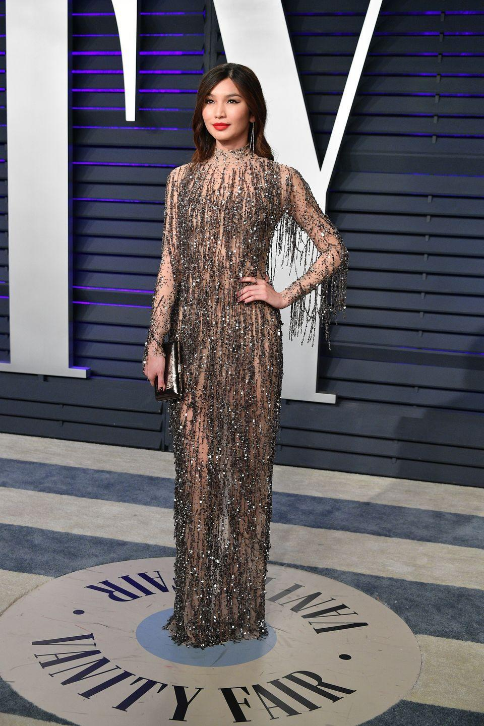 <p>The Oscar afterparty has become as infamous as it's conjoining award ceremony for it's star studded guest list and unforgettable fashion. Chan sparkled in a Tom Ford dress with an equally as decadent bag and shoes by Jimmy Choo.</p>