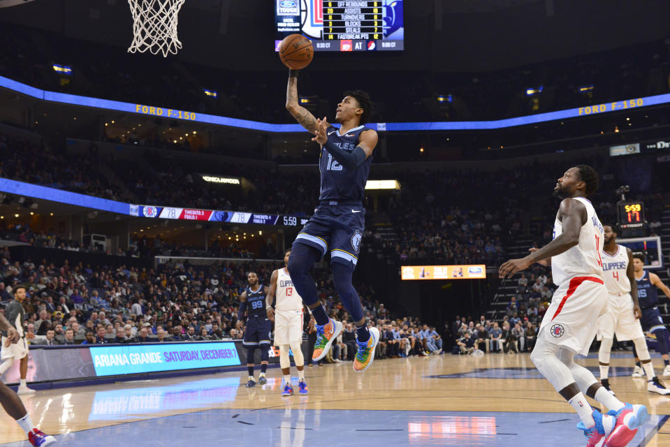 Memphis Grizzlies guard Ja Morant (12) goes up for a shot in the second half of an NBA basketball game against the Los Angeles Clippers Wednesday, Nov. 27, 2019, in Memphis, Tenn. (AP Photo/Brandon Dill)