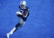 Nevada linebacker Lamin Touray (10) turns up field after intercepting a Tulane pass during the first half of the Idaho Potato Bowl NCAA college football game, Tuesday, Dec. 22, 2020, in Boise, Idaho. (AP Photo/Steve Conner)