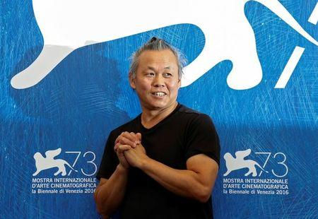 """Director Kim Ki-duk attends the photocall for the movie """"Geumul"""" at the 73rd Venice Film Festival in Venice"""