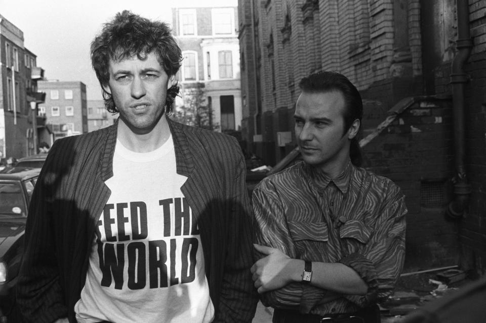 "Bob Geldof and Midge Ure outside SARM Studios during the recording of ""Do They Know It's Christmas?"" (Photo: Larry Ellis/Express Newspapers/Getty Images)"
