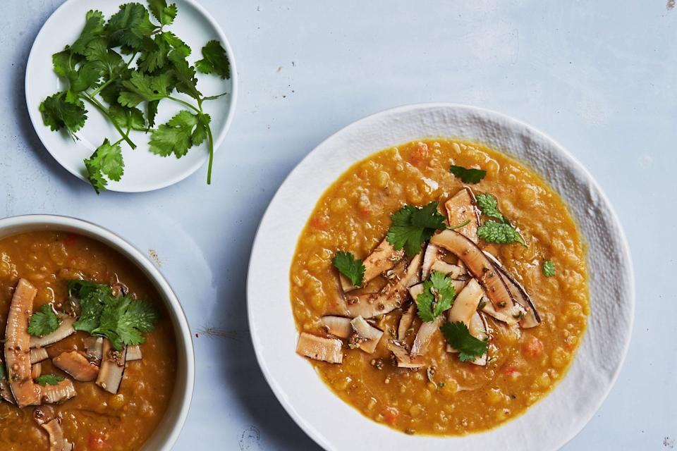 """Top this Madras curry–perfumed soup with earthy-sweet spiced coconut chips for a warming vegetarian dinner. <a href=""""https://www.epicurious.com/recipes/food/views/curried-yellow-split-pea-soup-with-spiced-coconut?mbid=synd_yahoo_rss"""" rel=""""nofollow noopener"""" target=""""_blank"""" data-ylk=""""slk:See recipe."""" class=""""link rapid-noclick-resp"""">See recipe.</a>"""