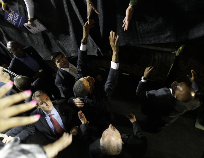 FILE - In this Monday, Oct. 27, 2008 file photo, Democratic presidential candidate Sen. Barack Obama, D-Ill., shakes hands as he is protected by members of the U.S. Secret Service at a rally at the Mellon Arena in Pittsburgh. The Secret Service has been tarnished by a prostitution scandal that erupted April 13, 2012 in Colombia involving 12 Secret Service agents, officers and supervisors and 12 more enlisted military personnel ahead of President Barack Obama's visit there for the Summit of the Americas. (AP Photo/Alex Brandon)