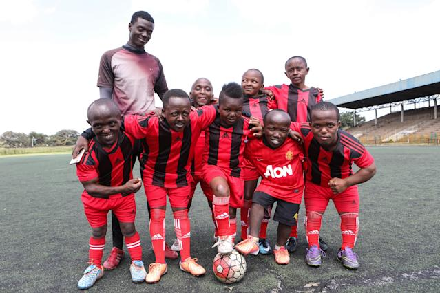 XDI11. Nairobi (Kenya), 29/05/2018.- Players of the Lion Stars, Kenya's first dwarf soccer team, pose for a group photo after a training session with their coach Gabriel Ochieng (back L) at the City Stadium in Nairobi, Kenya, 29 May 2018 (issued 14 July 2018). Lion Stars is an eight member men's dwarf soccer team, the first of their kind in Kenya, with players aged between 18 and 47 years old. Led by Gabriel Ochieng, a volunteer coach, the team aims transition from a recreational to a competitive one. They are planning to head to Argentina for the Copa Argentina tournament in October 2018 for friendly matches they have been invited to. Dwarf soccer has different rules to the mainstream version, in the interests of player safety. Headers are banned, for instance, to prevent spinal injuries, and if a player heads the ball, the other team will be awarded a free kick. Lion Stars is the only dwarf soccer team in East Africa and is working towards bringing Tanzania, Uganda and Rwanda into the fold. However, the team is facing several challenges, including financial sponsorship that would enable them to further their sporting endeavors. 'We face the challenge of ground, we face a challenge of balls, we face challenge of corns, we face challenge of uniform,' volunteer coach Ochieng said. They have reached out to the Kenyan government and well-wishers for help. The team was established with the help of the 'Short Stature Society of Kenya' to help counter stigmatization against people of short stature in the country by engaging in activities such as motivational speaking, theater, and community work as well as sporting activities such as weight-lifting, badminton and soccer. (Futbol, Amistoso, Kenia, Ruanda) EFE/EPA/DANIEL IRUNGU ATTENTION: This Image is part of a PHOTO SET