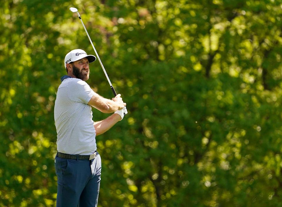 Dustin Johnson plays his second shot on the 11th hole during a practice round Wednesday.