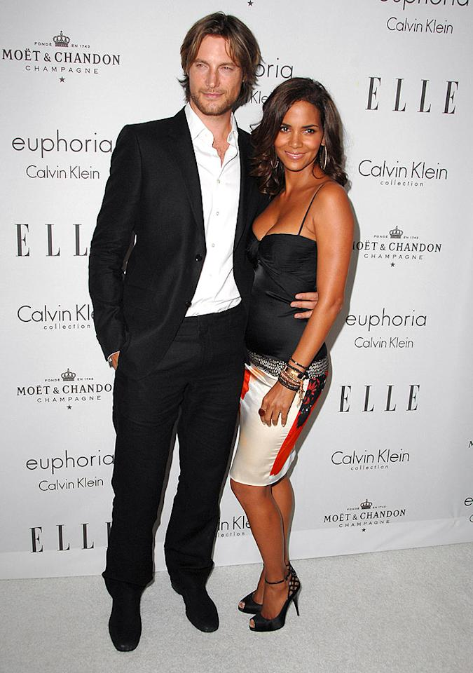 """Halle Berry may be Esquire's """"Sexiest Woman Alive,"""" but she's also spoken for. The actress and her model beau Gabriel Aubry turned heads at Elle's 15th Annual Women in Hollywood event last Monday. Gabriel confirmed that marriage isn't in their plans (after two failed marriages, Halle has vowed to never wed again), but let it slip that they're working on baby no. 2! Steve Granitz/<a href=""""http://www.wireimage.com"""" target=""""new"""">WireImage.com</a> - October 6, 2008"""