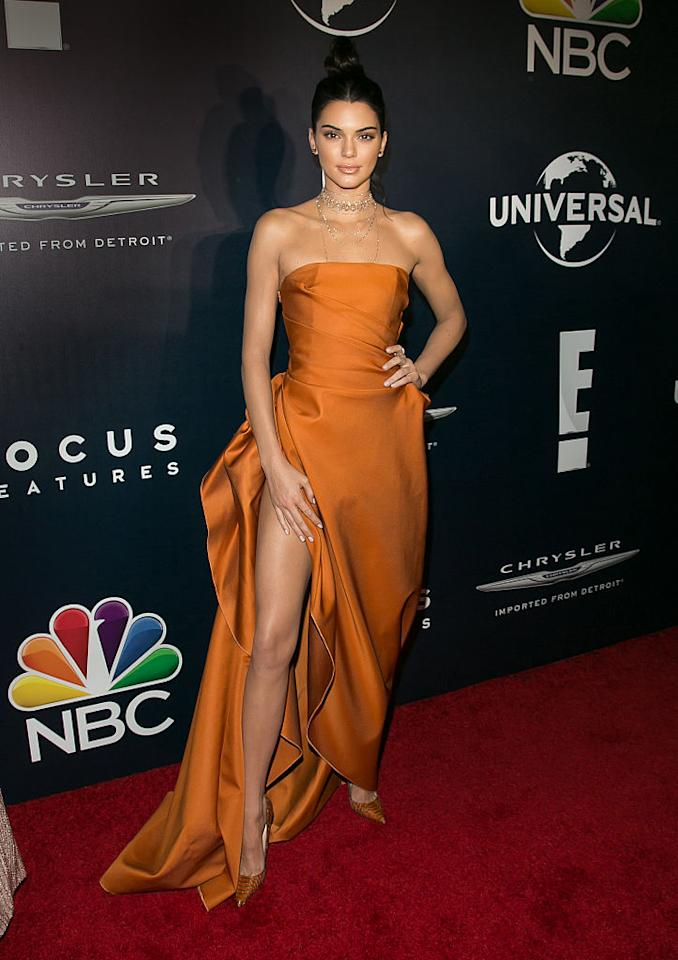 """<p>Kendall Jenner wore a $2,190 s<span>trapless burnt-orange <a rel=""""nofollow"""" href=""""https://www.modaoperandi.com/paule-ka-r17-2"""">Paule Ka</a> gown to</span> the NBCUniversal's 74th Annual Golden Globes afterparty at the Beverly Hilton Hotel on January 8, 2017. (Photo: Gabriel Olsen/FilmMagic) </p>"""