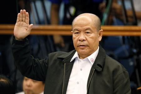 Lascanas takes an oath before testifying at the Philippine Senate inquiry on alleged extra judicial killings, in Manila