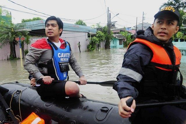 Actor and Barangay Captain of Cavite, Ramon 'Jolo' Revilla III together with the Philippine Navy of the Armed Forces of the Philippines looks for people to rescue inside Justinville, Bacoor Cavite on 07 August 2012. The Habagat (southwest monsoon) continues to bring scattered rain showers that caused flood in some parts of Cavite. (Angela Galia, NPPA images)