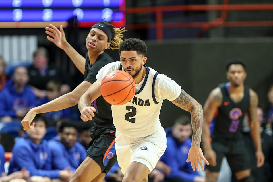 BOISE, ID - FEBRUARY 1: Guard Jalen Harris #2 of the Nevada Wolf Pack steals the ball from guard Derrick Alston #21 of the Boise State Broncos during second half action between the Nevada Wolf Pack at ExtraMile Arena on February 1, 2020 in Boise, Idaho. Boise State won the game 73-64. (Photo by Loren Orr/Getty Images)