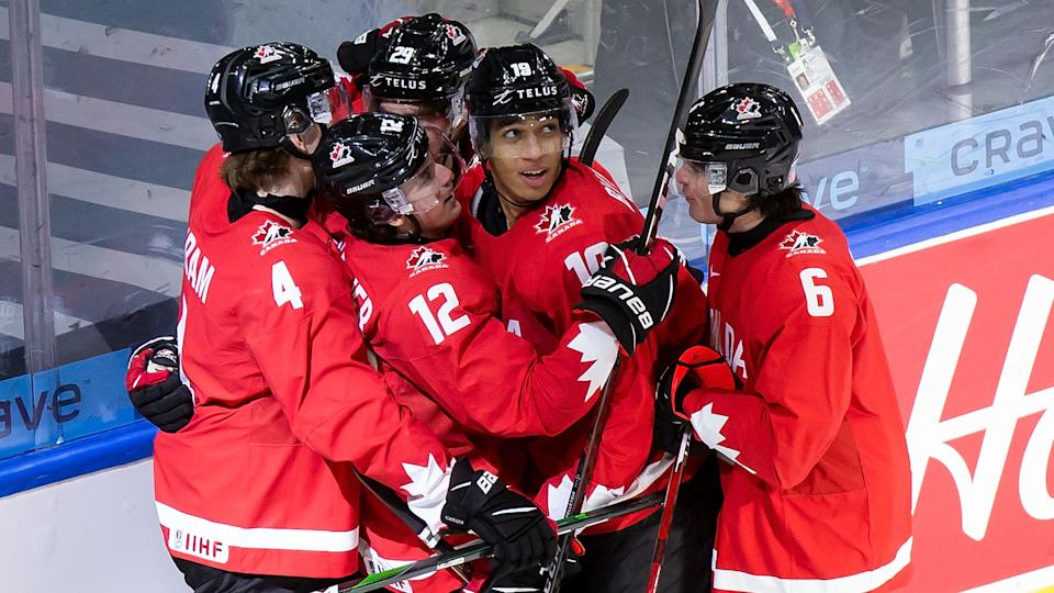 EDMONTON, AB - DECEMBER 29: Bowen Byram #4, Jakob Pelletier #12, Jack Quinn #29, Quinton Byfield #19 and Jamie Drysdale #6 of Canada celebrate Byfield's goal against Switzerland during the 2021 IIHF World Junior Championship at Rogers Place on December 29, 2020 in Edmonton, Canada. (Photo by Codie McLachlan/Getty Images)