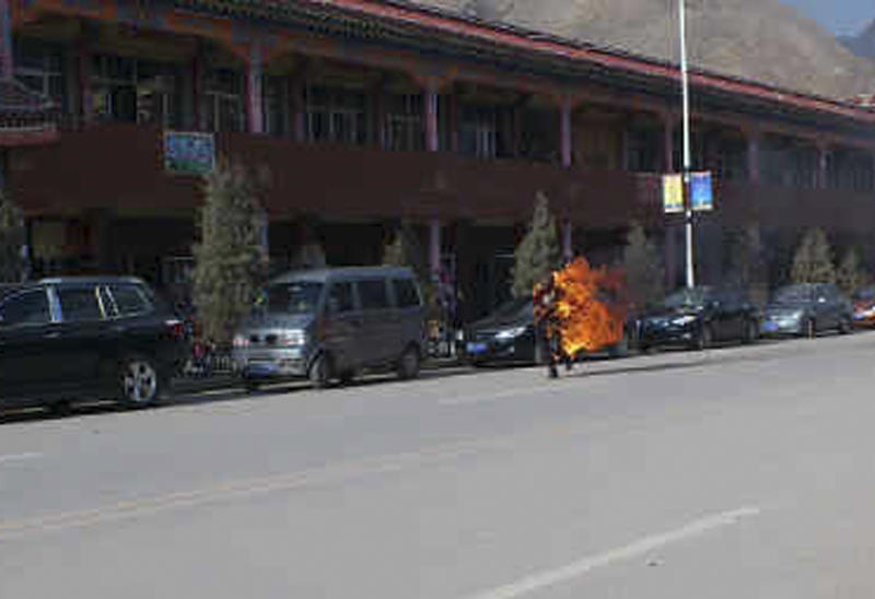 In this photo taken Tuesday Oct 23, 2012 and released by Washington-based International Campaign for Tibet, Dorje Rinchen, a farmer in his late 50s, is seen after setting himself on fire on the main street in Xiahe in northwestern China's Gansu province. This was the second self-immolation death in two days near the Labrang monastery in Xiahe. The monastery is one of the most important outside Tibet and was the site of numerous protests by monks following deadly ethnic riots in Tibet in 2008 that were the most sustained Tibetan uprising against Chinese rule in decades.(AP Photo/International Campaign for Tibet) EDITORIAL USE ONLY, NO SALES