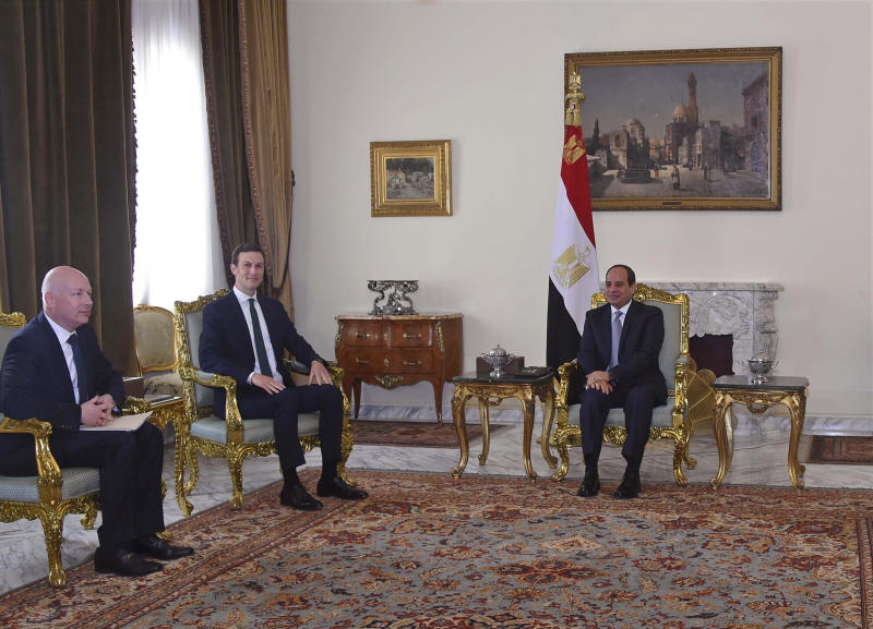 In this Thursday, June 21, 2018 photo, provided by Egypt's state news agency, MENA, Egyptian President Abdel-Fattah el-Sissi, center, meets with President Donald  Trump's son-in-law and senior adviser Jared Kushner, second left, and Mideast envoy Jason Greenblatt on the latest stop in a regional tour to discuss a blueprint for an Israeli-Palestinian peace deal, in Cairo, Egypt. (MENA via AP)