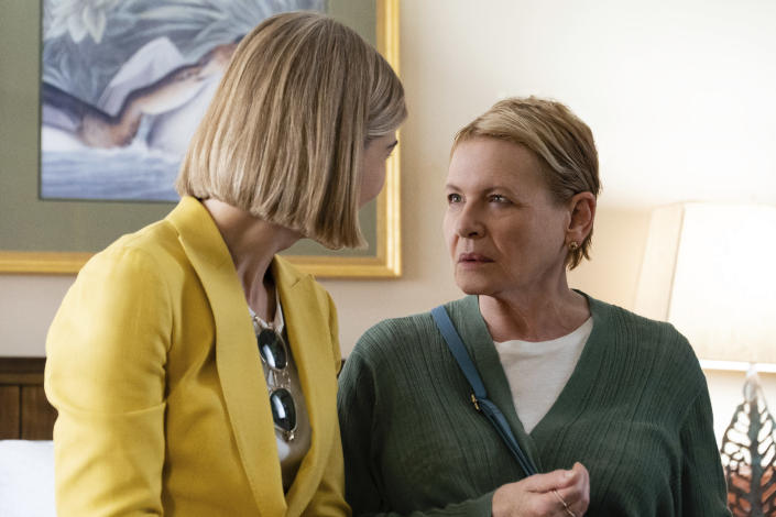 """This image released by Netflix shows Rosamund Pike, left, and Dianne Wiest in a scene from """"I Care A Lot."""" (Seacia Pavao/Netflix via AP)"""