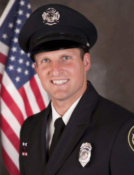 This undated photo provided by the Appleton, Wis., Police Department shows Appleton firefighter Mitch Lundgaard. Lundgaard was killed in a shooting at a Wisconsin bus station while responding to an emergency call Wednesday, May 15, 2019. A call to assist a man thought to be having a medical emergency on a bus escalated into a shooting that ended with the man and Lundgaard dead and two others hurt. (Appleton Police Department via AP)