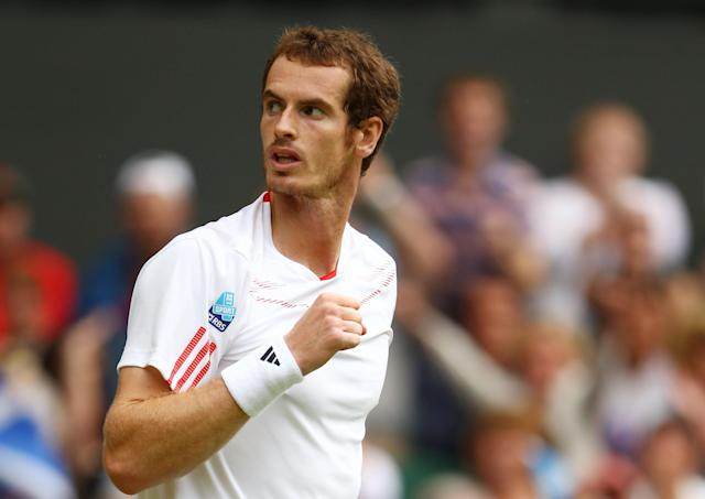 LONDON, ENGLAND - JULY 04: Andy Murray of Great Britain celebrates set point during his Gentlemen's Singles quarter final match against David Ferrer of Spain on day nine of the Wimbledon Lawn Tennis Championships at the All England Lawn Tennis and Croquet Club on July 4, 2012 in London, England. (Photo by Clive Brunskill/Getty Images)