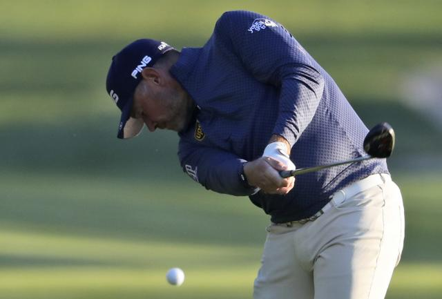 England's Lee Westwood plays a shot on the 10th fairway during the second round of the Abu Dhabi Championship golf tournament in Abu Dhabi, United Arab Emirates, Friday, Jan. 17, 2020. (AP Photo/Kamran Jebreili)