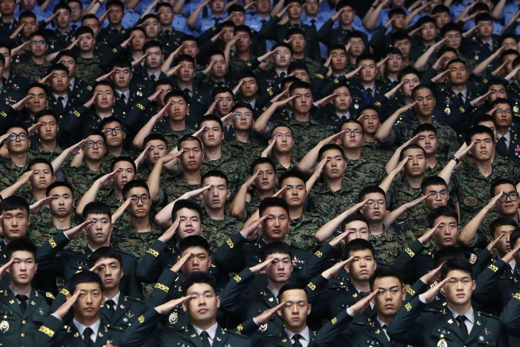 <p>South Korean soldiers salute during a ceremony to mark the 68th anniversary of the Korean War in Seoul, South Korea. Over 66,000 South Koreans have been separated from their families during the Korean War which started on June 25, 1950, and effectively split the Korean Peninsula into two over the 3-year conflict. The fighting between North and South Korea ended on July 27, 1953, with the signing of the Korean Armistice Agreement and the heavily guarded Demilitarized Zone was created, however, both countries remain technically still at war since no peace agreement was signed and many Koreans died before they could reunite with their loved ones. (Chung Sung-Jun/Getty Images) </p>