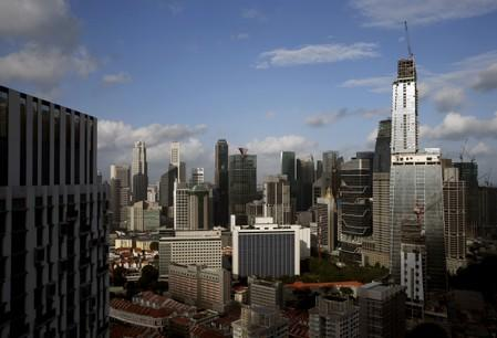 FILE PHOTO: GuocoLand Ltd's mixed-use Tanjong Pagar Centre, soon to be the tallest building in the city-state, towers over other buildings in the central business district of Singapore