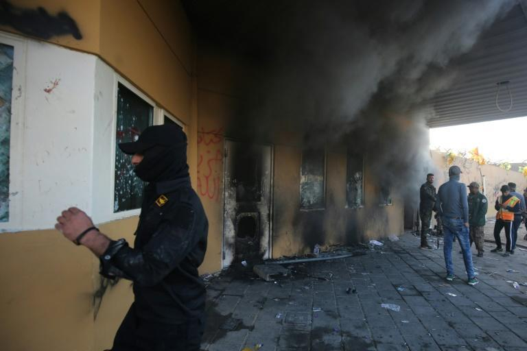Smoke billows from the entrance of the US embassy in Baghdad after pro-Iran protesters tried to break into the building during a rally to vent anger over deadly US air strikes