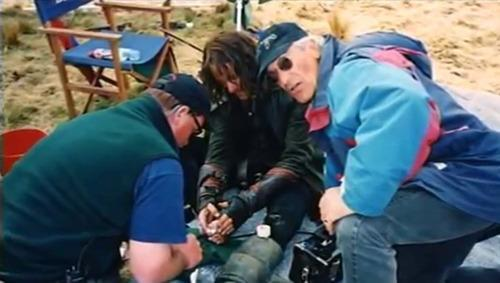 Medics can be seen attending to Mortensen's injury on the DVD extras. (Warner Bros.)