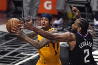 Utah Jazz guard Jordan Clarkson, left, tries to pass while under pressure from Los Angeles Clippers forward Kawhi Leonard during the first half in Game 4 of a second-round NBA basketball playoff series Monday, June 14, 2021, in Los Angeles. (AP Photo/Mark J. Terrill)
