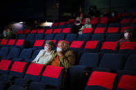Cinema audiences watch Nomadland inside a movie theatre screen at Chapter, Cardiff, Wales as indoor hospitality and entertainment venues reopen to the public following the further easing of lockdown restrictions in Wales, Monday May 17, 2021. (Ben Birchall/PA via AP)