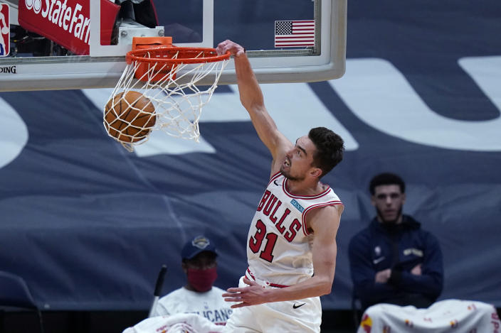 Chicago Bulls guard Tomas Satoransky dunks during the first half of the team's NBA basketball game against the New Orleans Pelicans in New Orleans, Wednesday, March 3, 2021. (AP Photo/Gerald Herbert)