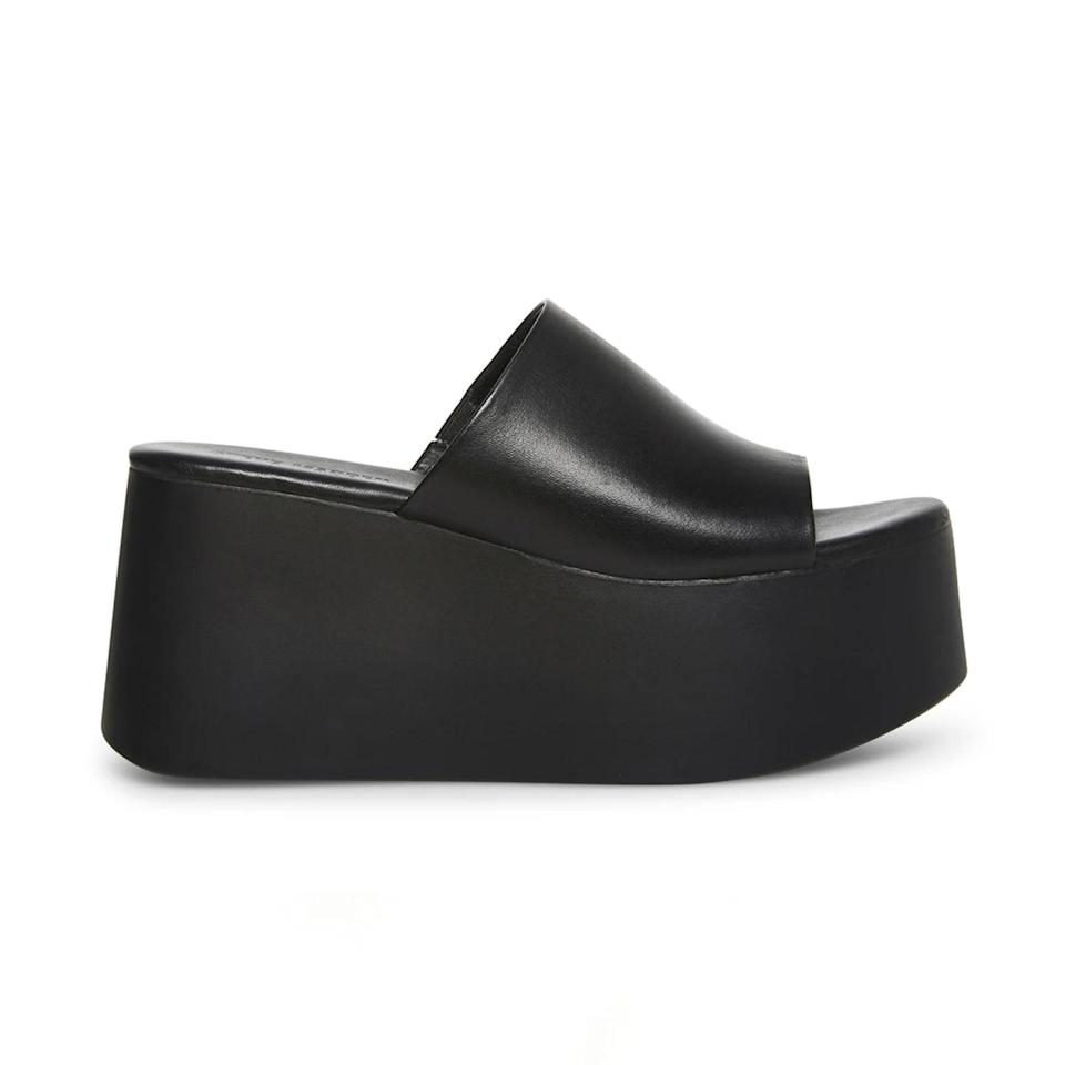 """You know that meme that shows a pair of Steve Madden slides that says, """"If you wore these, it's time for a night serum?"""" Well, the chunky, black Steve Madden slides of our youth are back, whether you like them or not. This updated leather version also comes in pastel pink. Feel free to spend your summer over three inches taller, binge-watching old episodes of <a href=""""https://www.glamour.com/story/the-lizzie-mcguire-cast-responds-to-the-reboot-cancellation-it-just-seems-ridiculous?mbid=synd_yahoo_rss"""" rel=""""nofollow noopener"""" target=""""_blank"""" data-ylk=""""slk:Lizzie McGuire"""" class=""""link rapid-noclick-resp""""><em>Lizzie McGuire</em></a> for the entire nostalgic experience. $90, Steve Madden. <a href=""""https://www.stevemadden.com/products/christa-black-leather?"""" rel=""""nofollow noopener"""" target=""""_blank"""" data-ylk=""""slk:Get it now!"""" class=""""link rapid-noclick-resp"""">Get it now!</a>"""