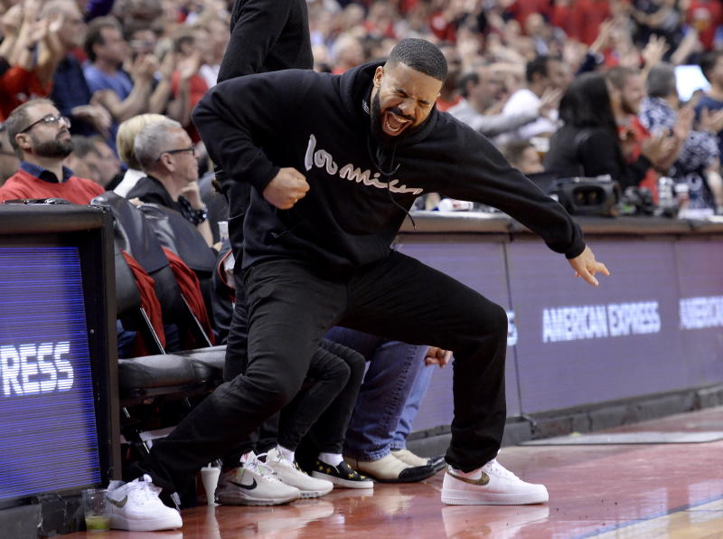 Drake reacts to a 3-point basket during the second half of Game 6 of the NBA basketball playoffs Eastern Conference finals between the Toronto Raptors and the Milwaukee Bucks on Saturday, May 25, 2019, in Toronto. (Nathan Denette/The Canadian Press via AP)