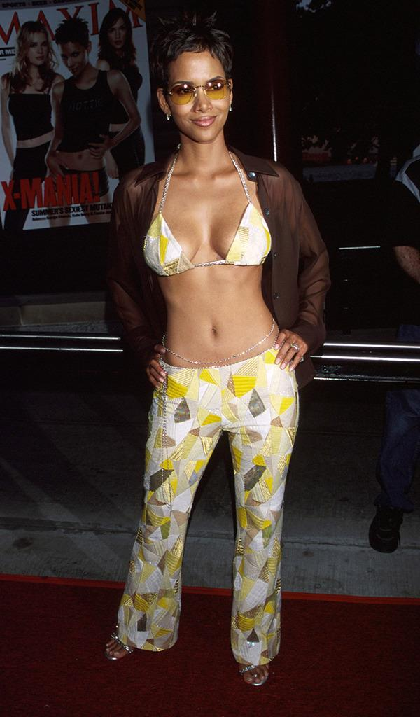<p>Berry, who played weather-manipulating mutant Storm in <i>X-Men,</i> arrived to the premiere in a bedazzled bikini top. She reprised the role in <i>X2: X-Men United</i>, <i>X-Men: The Last Stand</i>, and <i>X-Men: Days of Future Past</i>.<i> (Photo: Kevin Mazur/WireImage)</i></p>
