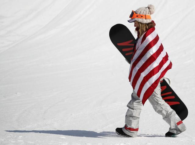 Snowboarding - Pyeongchang 2018 Winter Olympics - Women's Big Air Final Run 3 - Alpensia Ski Jumping Centre - Pyeongchang, South Korea - February 22, 2018 - Silver medallist Jamie Anderson of the U.S. wears the U.S. flag around her shoulders. REUTERS/Kim Hong-Ji