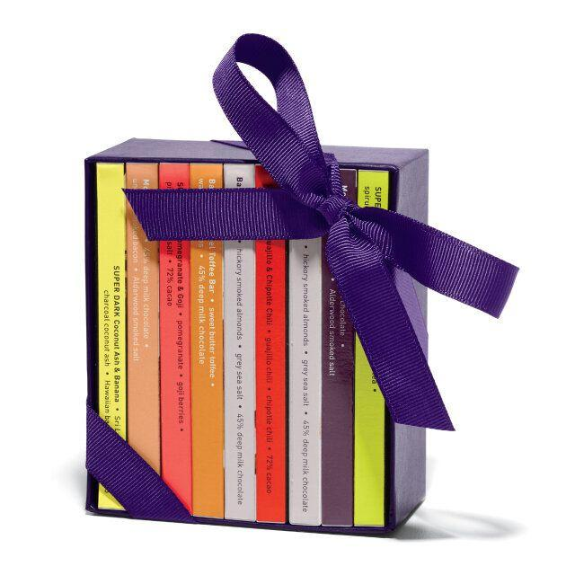 """Books are amazing. Fancy chocolate is delicious. Why not combine the two? This set from Vosges has bars of both dark and milk chocolate that look like an adorable library. <a href=""""http://www.vosgeschocolate.com/product/mini-exotic-candy-bar-library"""" target=""""_blank"""">Get it here.</a>"""